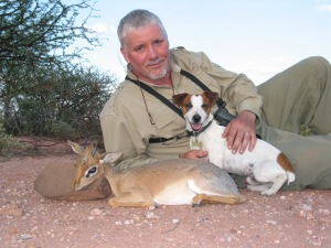Dik dik with a dog and man to show proportion